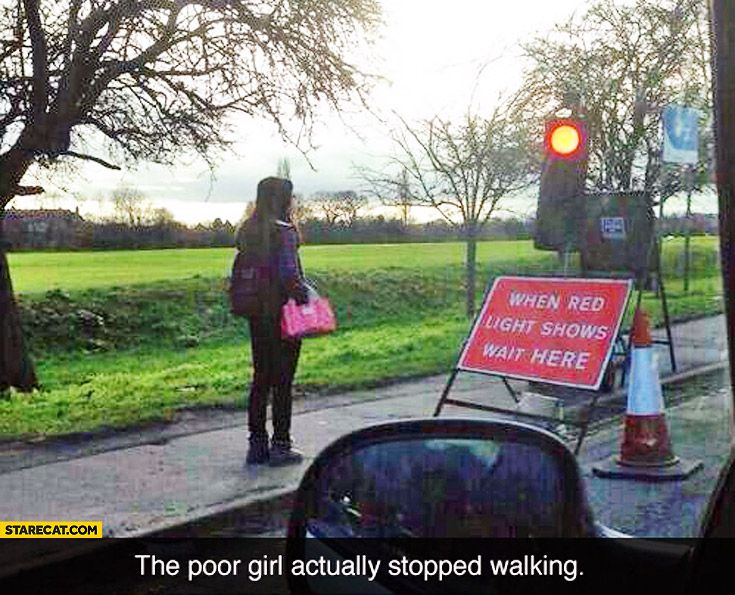 When red light shows wait here the poor girl actually stopped walking
