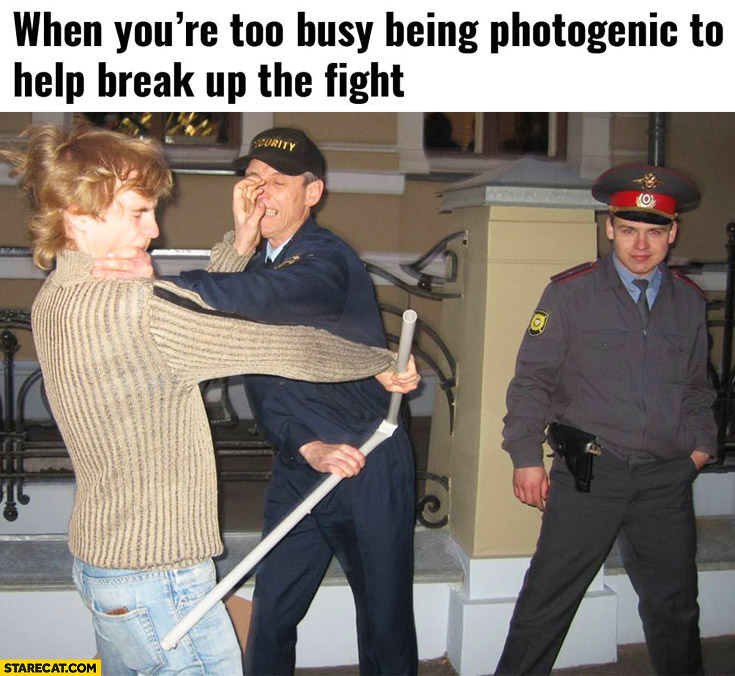 When you're too busy being photogenic to help break the fight policeman