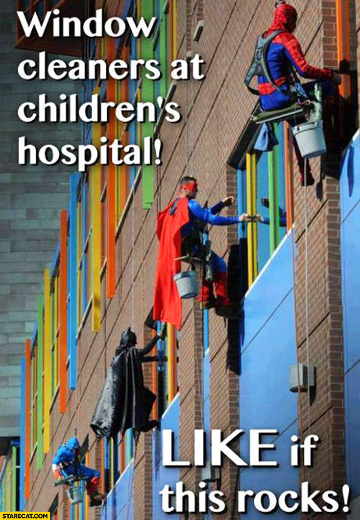 Window cleaners at children's hospital superheroes: Batman, Superman, Spiderman