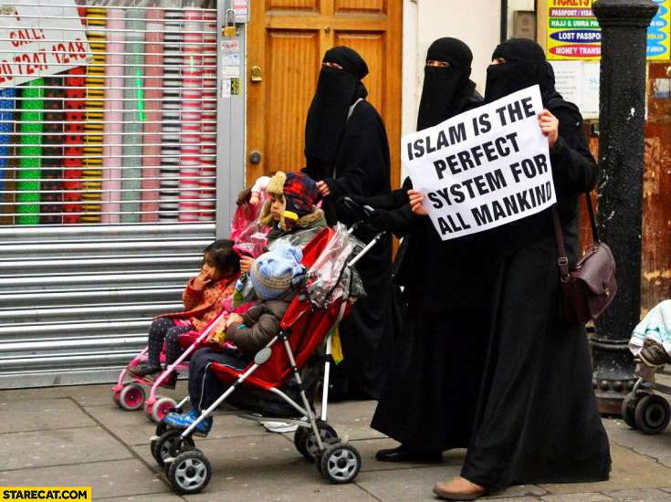 "Women wearing burka hijab with sign ""Islam is the perfect system for all mankind"""