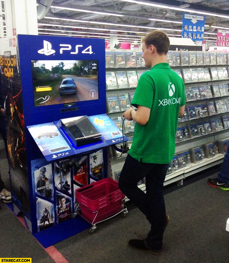 X-box salesman playing PS4