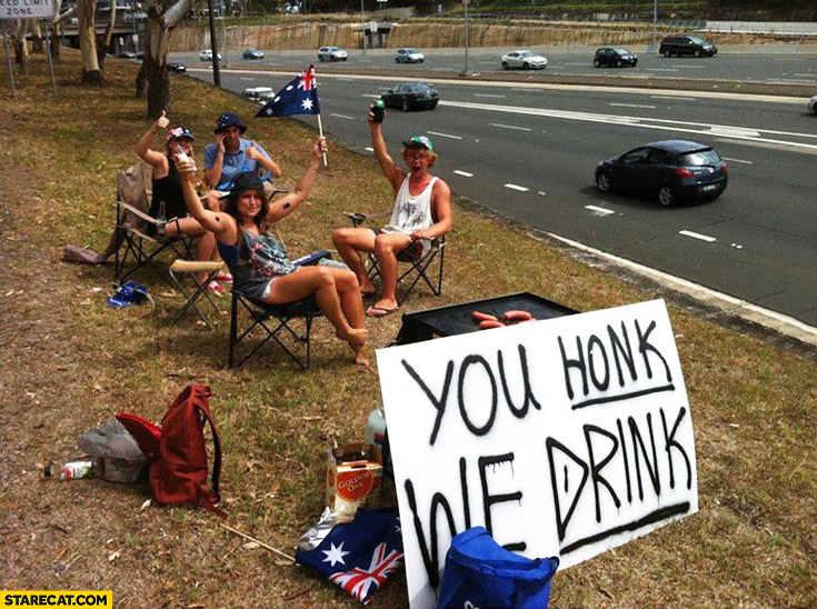 You honk, we drink. Australians on the side of a road