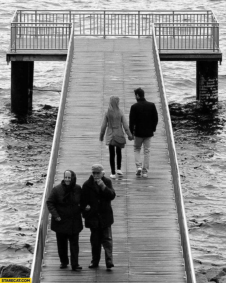 Young and old couples walking on a pier cute picture